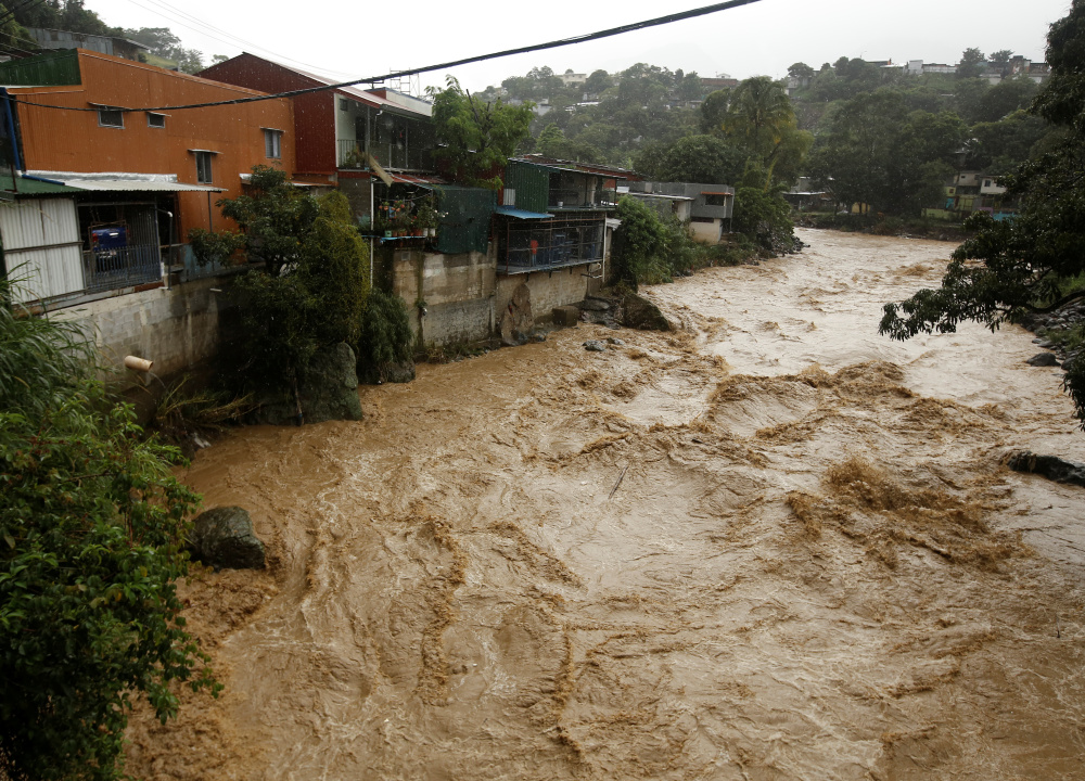 The flooded Tiribi River is seen during heavy rains from Tropical Storm Nate in San Jose, Costa Rica, on Thursday.