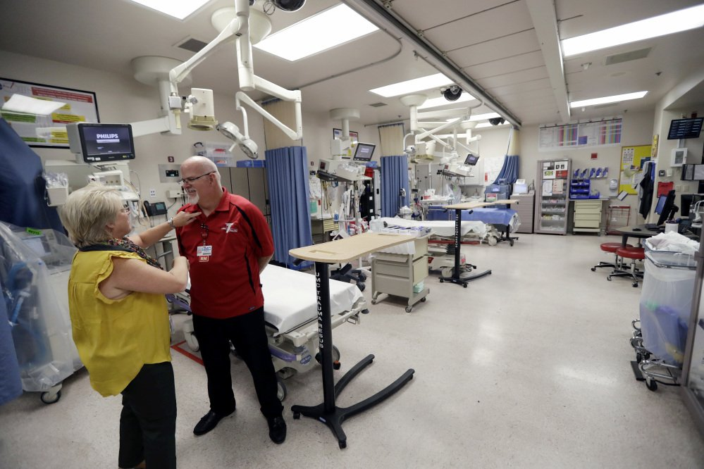 Toni Mullan, left, adjusts the shirt of Brad Skillang in the trauma unit at the University Medical Center on Tuesday in Las Vegas. Skillang and Mullan are clinical nurse supervisors in the trauma unit, and were on duty as victims of Sunday's mass shooting began to arrive.