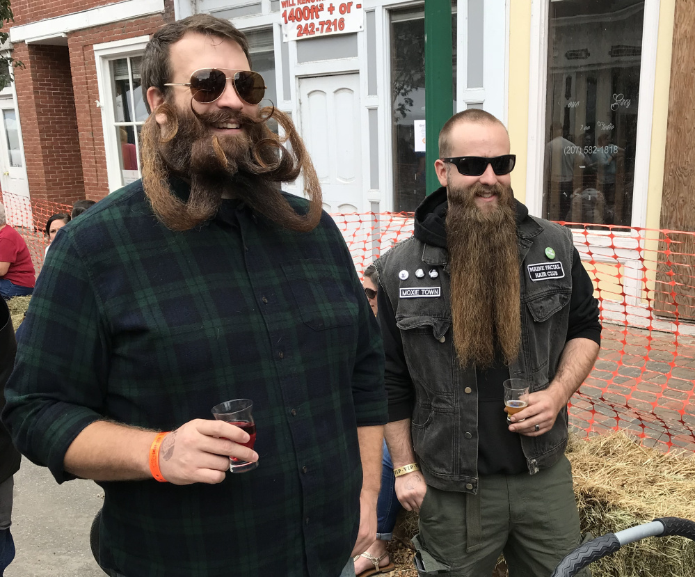 Bryce Royal, left, and Zachary LeClair show off their whiskers during the eighth annual Swine & Stein Oktoberfest in Gardiner on Saturday.