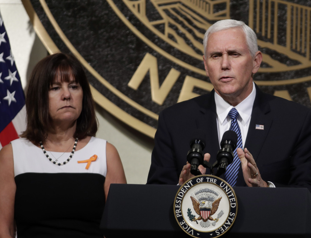 Vice President Mike Pence, accompanied by his wife, Karen, speaks in Las Vegas on Saturday following a unity prayer walk honoring the victims of last weekend's massacre.