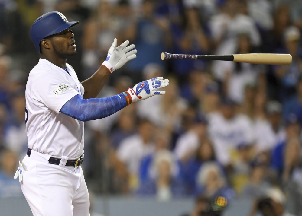 L.A.'s Yasiel Puig celebrates after a single against Arizona during the fourth inning of Game 2 on Saturday night.