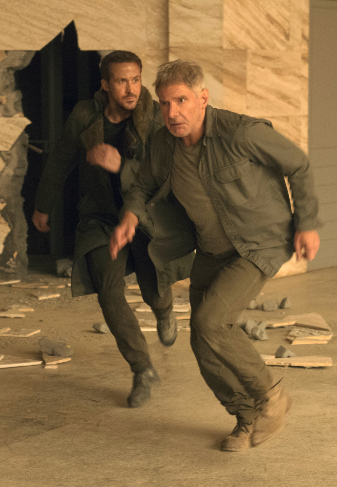 Ryan Gosling, left, and Harrison Ford appear in a scene from