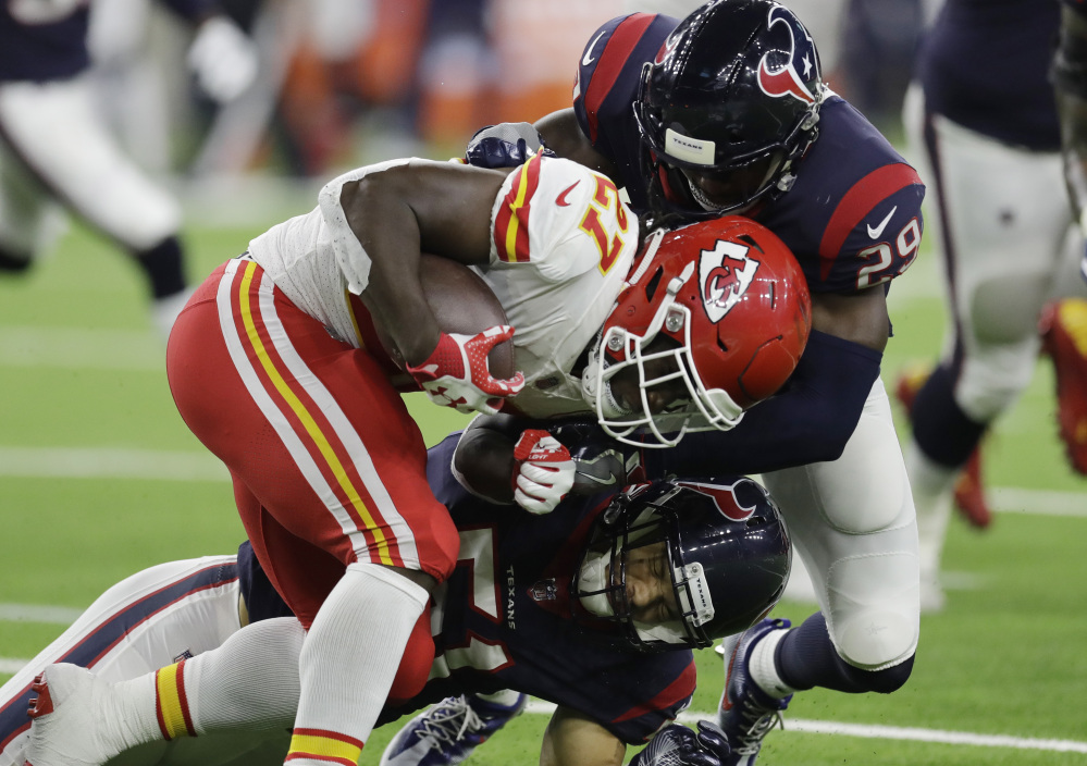 Chiefs running back Kareem Hunt is hit by Houston free safety Andre Hal. Hunt continued his stellar rookie season with 107 yards on 29 carries in Kansas City's 42-34 victory.