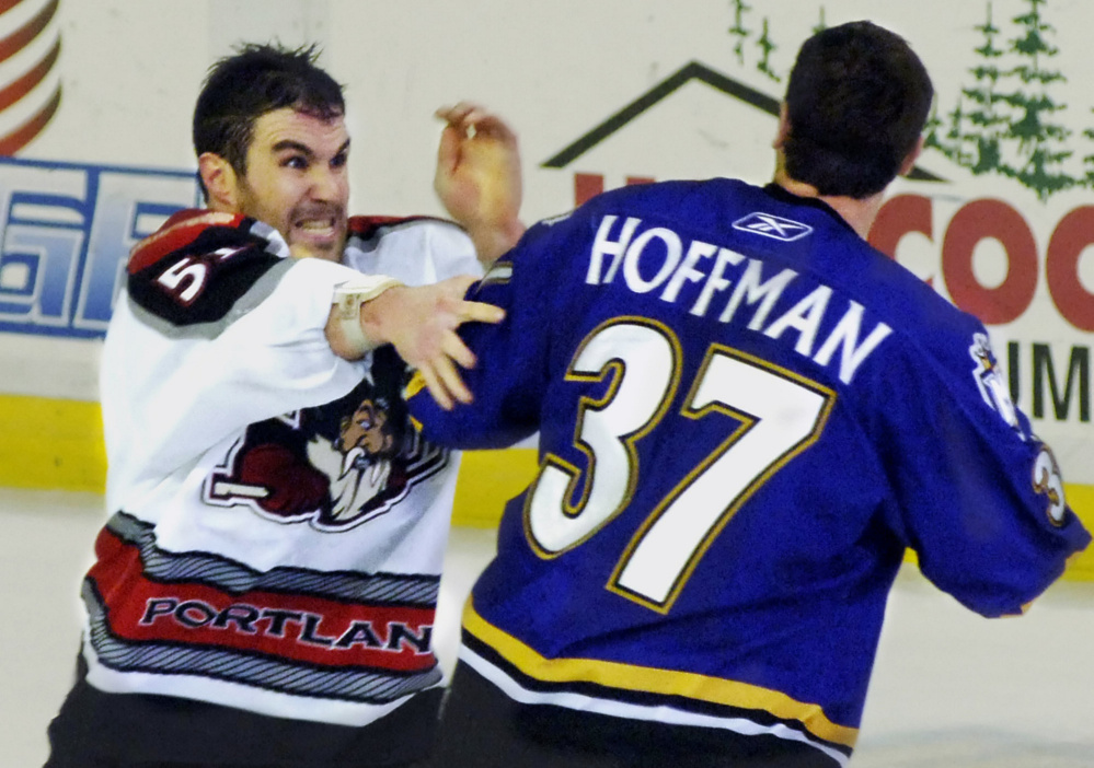 Trevor Gillies, left, and Mike Hoffman became Portland Pirates teammates shortly after this fight in 2006. Gillies, still an active player, is sad to see fighting being phased out.