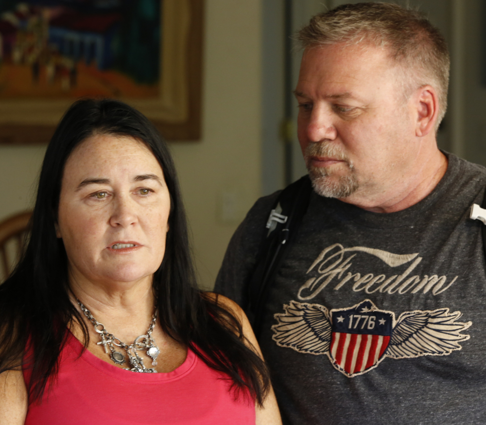 Country music fan Julie Hart, with her boyfriend, Mark Gay, recounts fleeing from the mass shooting at the Route 91 Harvest festival in Las Vegas on Oct. 1, during an interview at her family home in Anaheim Hills, Calif.