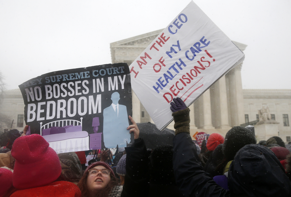 Demonstrators rally in Washington in 2014 in support of the Affordable Care Act requirement that employers cover contraception in their health insurance plans. Under a new federal rule, any