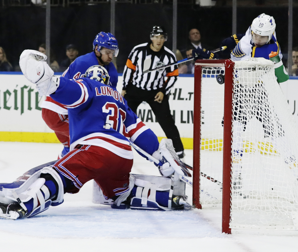 Brayden Schenn of the Blues shoots the puck past Rangers goalie Henrik Lundqvist during the first period of Tuesday's game in New York. St. Louis won 3-1 to go to 4-0.