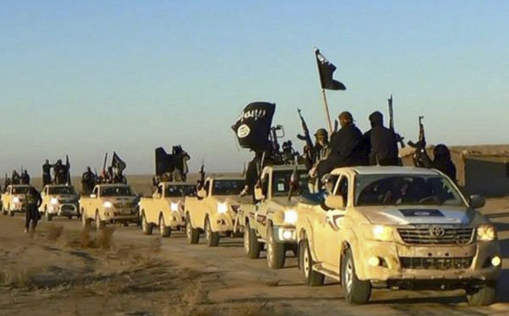 An undated website photo shows Islamic State militants on a convoy in Raqqa, Syria. In the past three weeks, up to 15 militants, including a senior leader, have surrendered in Raqqa.