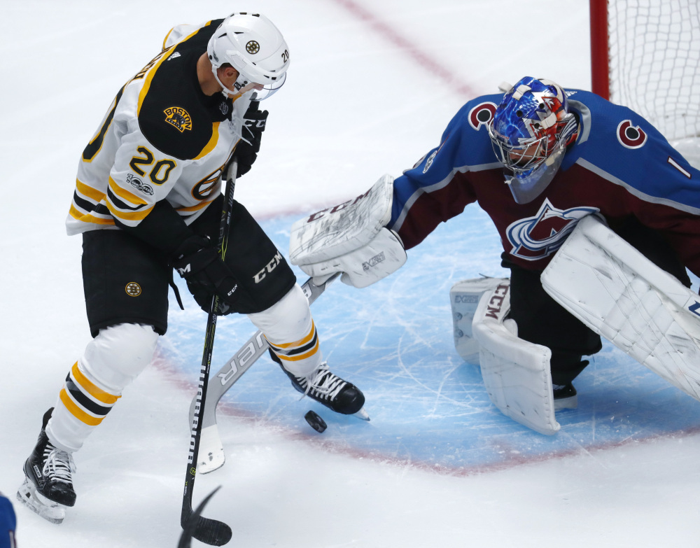 Bruins center Riley Nash tries to redirect a shot past Colorado goalie Semyon Varlamov in the first period Wednesday night in Denver.