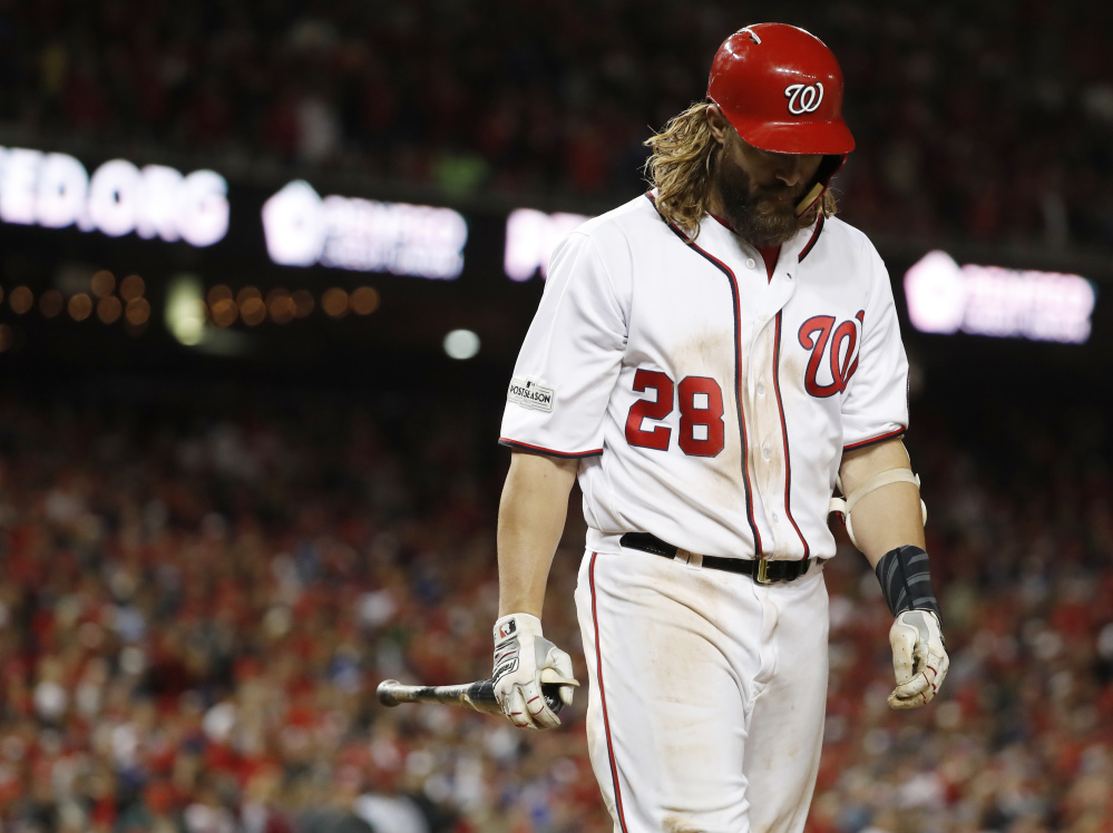 The Nationals' Jayson Werth walks away from the plate after striking out in the ninth inning.