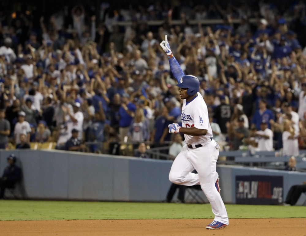 Los Angeles Dodgers Yasiel Puig celebrates his home run against Chicago during the seventh inning on Saturday night.