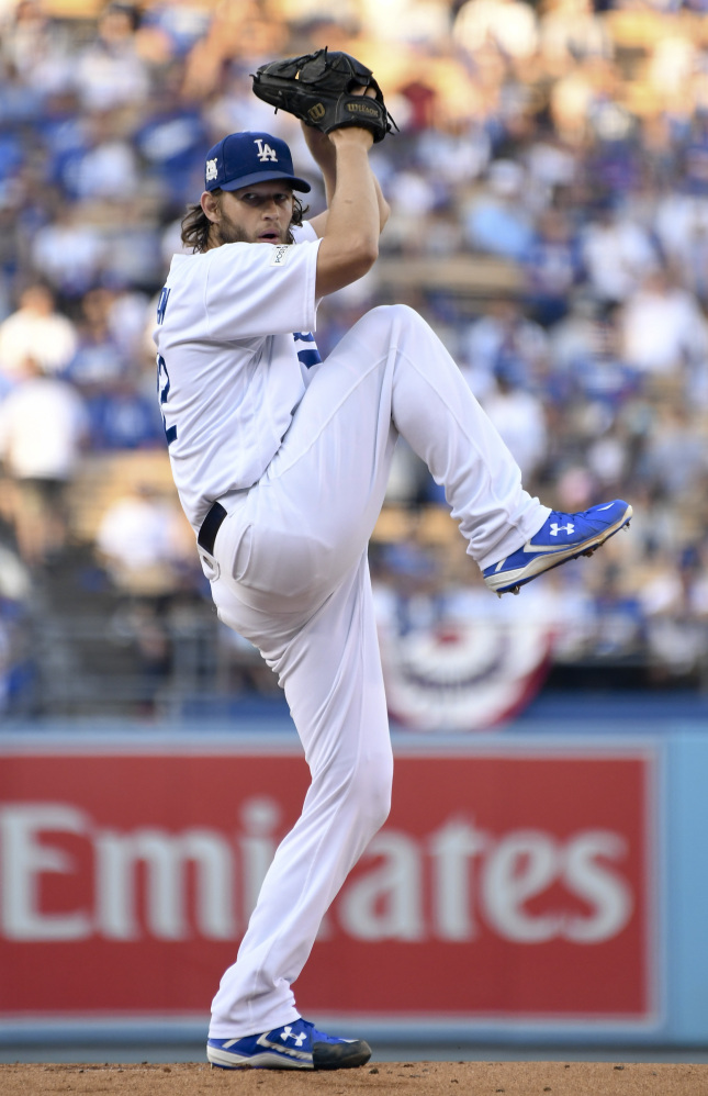 Dodgers starting pitcher Clayton Kershaw winds up during the first inning.