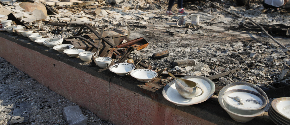 A set of salvaged china lines the foundation of a burned home in Santa Rosa, Calif. Some agencies want the cost of fighting wildfires to be covered by the federal Disaster Relief Fund.