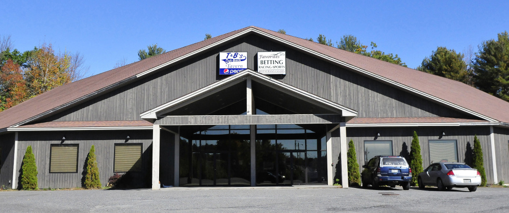 A lawsuit alleges a former employee stole almost $700,000 from the Favorites business, above, in Waterville, owned by Pioneer Gaming LLC.