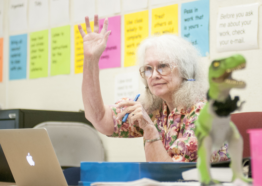 Phyllis McDonough, 72, helps freshmen review for a test in her Western Civilization class at Hall-Dale High School in Farmingdale. Her classroom's mascot is a T. Rex, on her desk above, because student joke that she's been around since the age of the dinosaur.