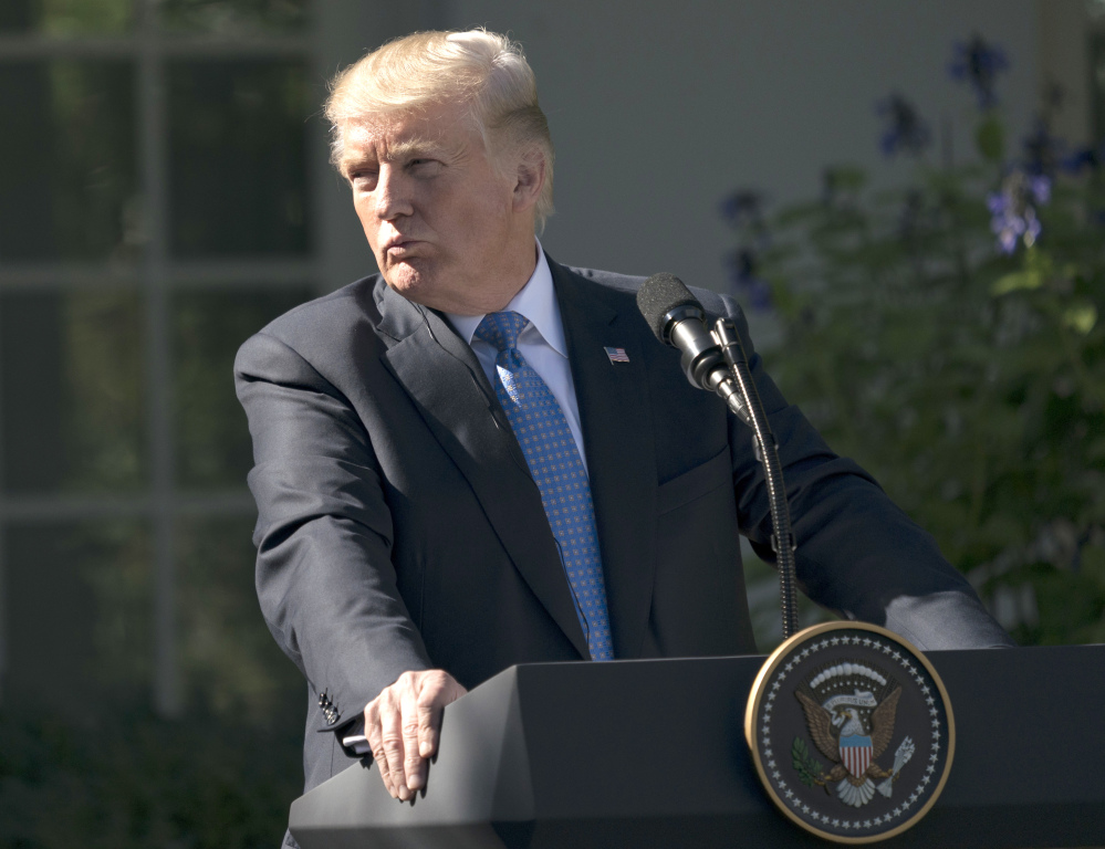 President Trump pauses Tuesday during a news conference with Greek Prime Minister Alexis Tsipras in the Rose Garden of the White House. A federal judge in Hawaii has blocked Trump's third attempt at a travel ban.