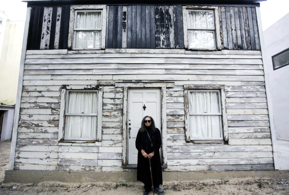 Rhea McCauley, a niece of the late civil rights activist Rosa Parks, poses in front of Parks' rebuilt house in April.