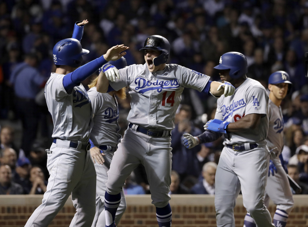 Enrique Hernandez of the Dodgers celebrates after hitting a grand slam in the third inning Thursday night in Chicago.