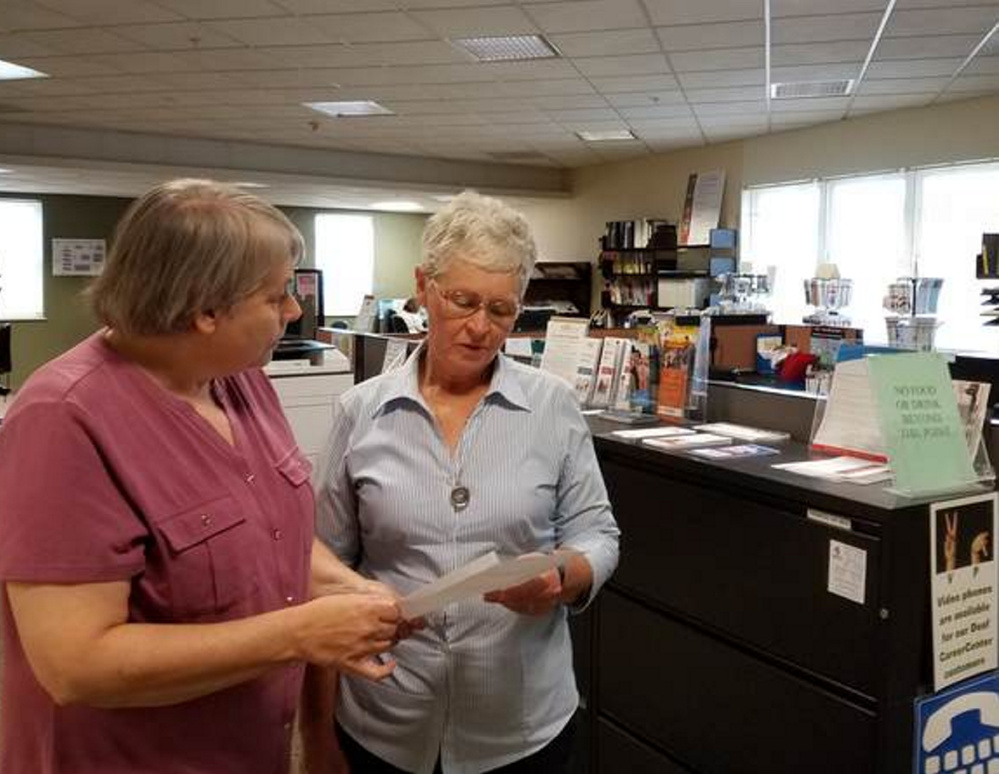 Patty Ladd, left, talks with Pat Morse at the Wilton CareerCenter. Ladd and Morse are among 14 Western Maine Community Action employees who received conditional layoff notices.