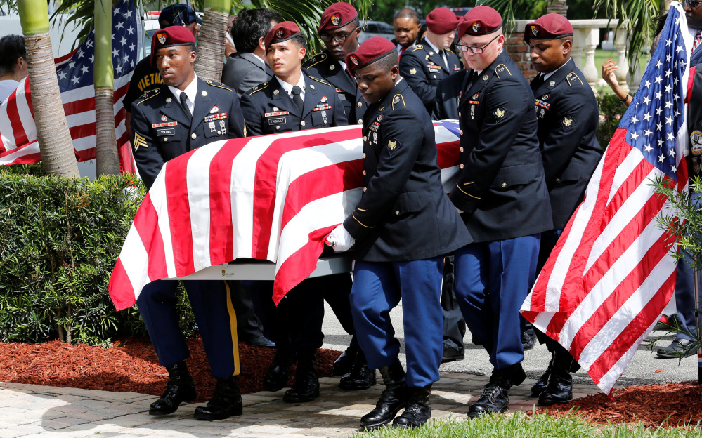 An honor guard carries the coffin of Army Sgt. La David Johnson at a graveside service in Hollywood, Fla., on Saturday.