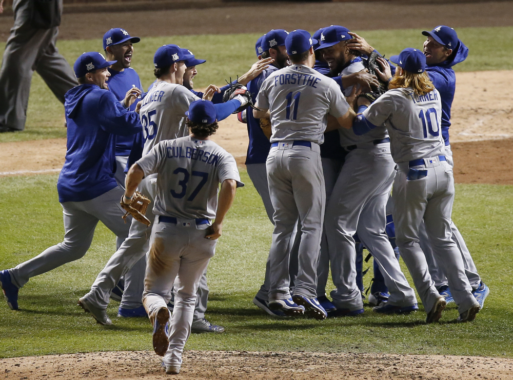 Los Angeles Dodgers players celebrate after winning Game 5 of the NL Championship Series to eliminate the Chicago Cubs last Thursday. The Dodgers are in the World Series for the first time since 1988 after winning a major league-high 104 games and cruising through the NL playoffs.