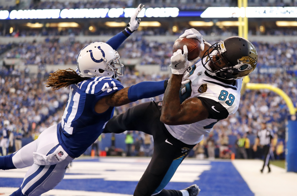 Jacksonville tight end Marcedes Lewis makes a catch for a touchdown over Indianapolis strong safety Matthias Farley during the Jaguars' 27-0 win Sunday in Indianapolis.