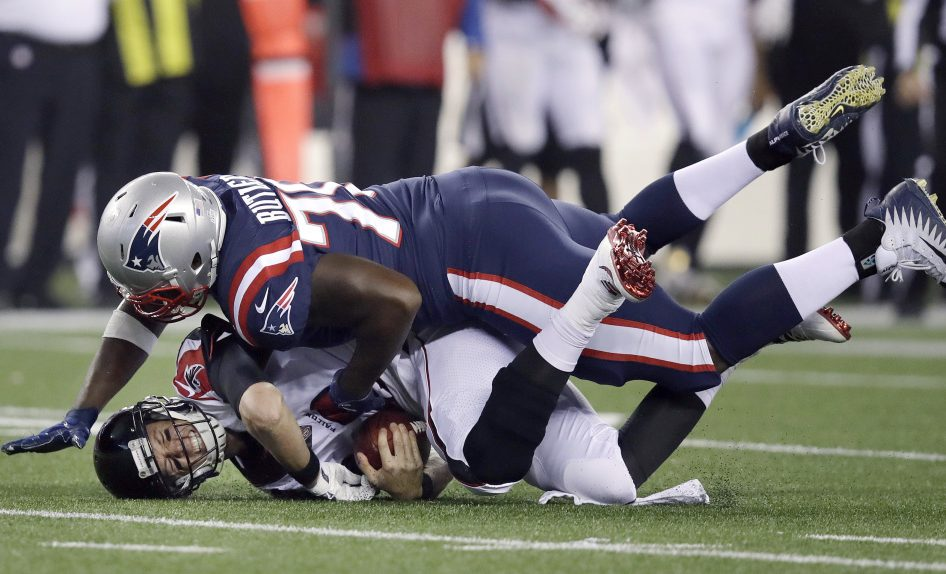 Patriots defensive tackle Adam Butler sacks Atlanta quarterback Matt Ryan in Sunday night's game. New England held Ryan to 233 passing yards in the game, the first time this season an opposing quarterback has not surpassed 300 yards against New England.