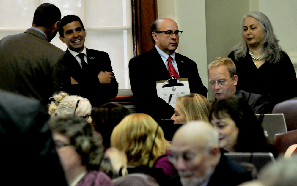 Secretary of State Matthew Dunlap, center, listens in on Monday's special session in the House. He said he never took a position against ranked-choice voting but provided information to lawmakers about how it could be implemented and what might happen in the event of a court challenge.