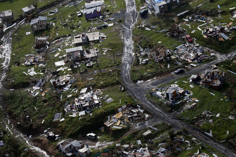 Debris scatters a destroyed community in the aftermath of Hurricane Maria in Toa Alta, Puerto Rico. The Senate gave preliminary approval Monday to a $36.5 billion hurricane relief package that would give Puerto Rico a much-needed infusion of cash. A final vote likely on Tuesday. (Associated Press/Gerald Herbert)