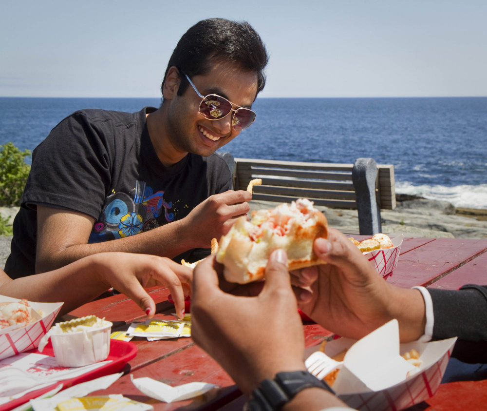 Yogesh Kauntia dines at Two Lights Lobster Shack in Cape Elizabeth in 2014. Next year, a single trade group will represent restaurants and lodging interests in an industry that had combined revenue of $3.5 billion in 2016.
