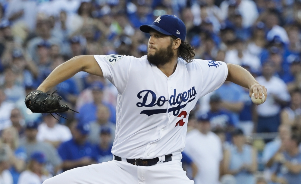 Los Angeles Dodgers starting pitcher Clayton Kershaw throws during the first inning of Game 1 of the World Series against the Houston Astros on Tuesday in Los Angeles.