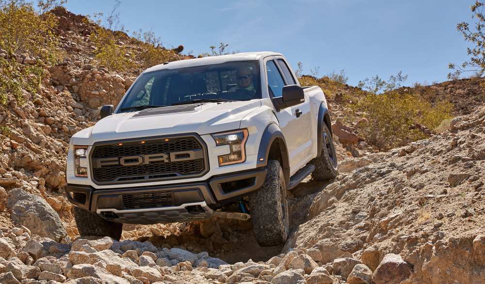 Sales of the popular F-Series trucks, like this F-150 Raptor, climbed 14 percent in the third quarter, while Ford's passenger-car sales have fallen.