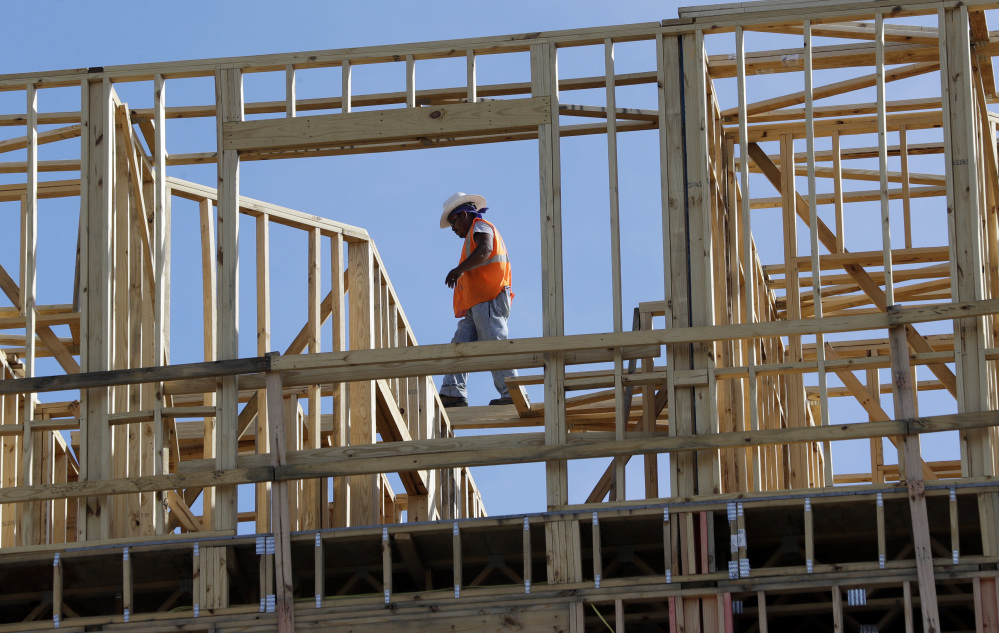 Workers build apartments in Nashville, Tenn. Friday's figures mark the first time in three years that the U.S. economy grew at a 3 percent annual rate for two straight quarters.