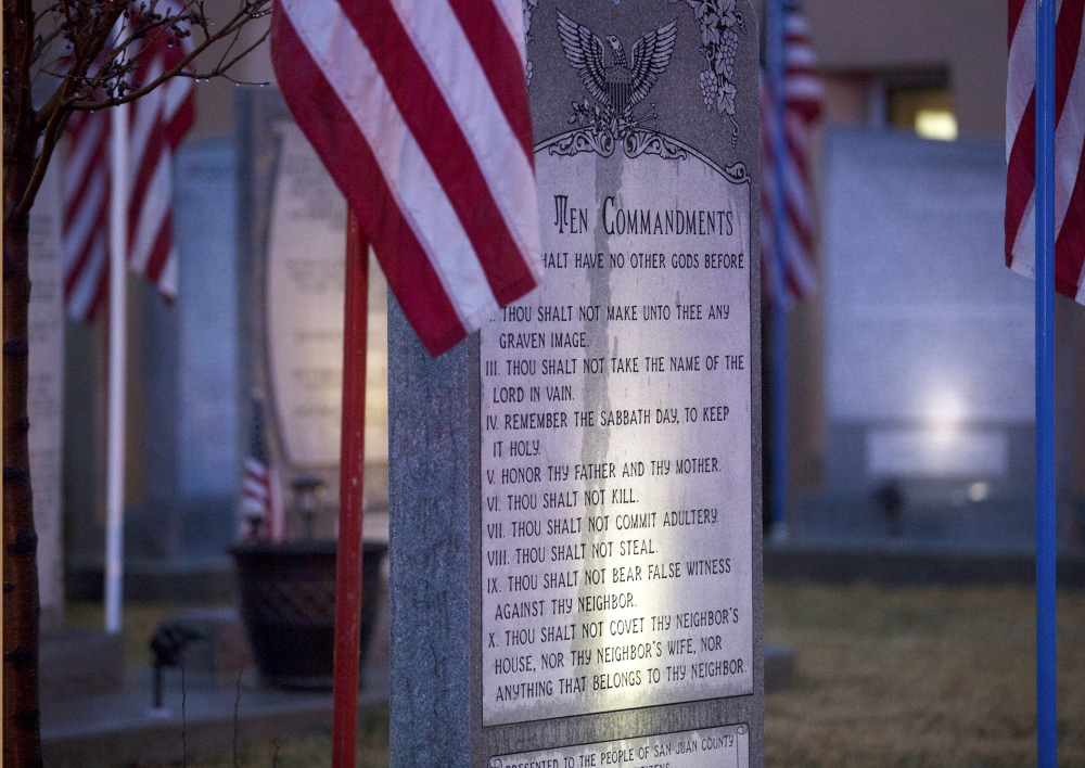 The Ten Commandments memorial stands at Bloomfield City Hall in Bloomfield, N.M. The U.S. Supreme Court last week sided with a ruling by the 10th U.S. Circuit Court of Appeals that ordered Bloomfield to remove the Ten Commandments monument from the lawn outside City Hall.