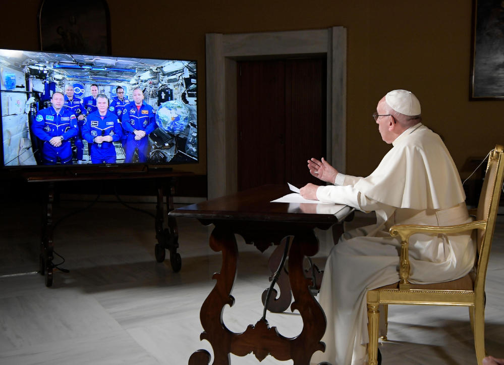 Pope Francis speaks to the International Space Station crew from the Vatican on Thursday.  One American told him seeing Earth's beauty from there inevitably touches the soul.