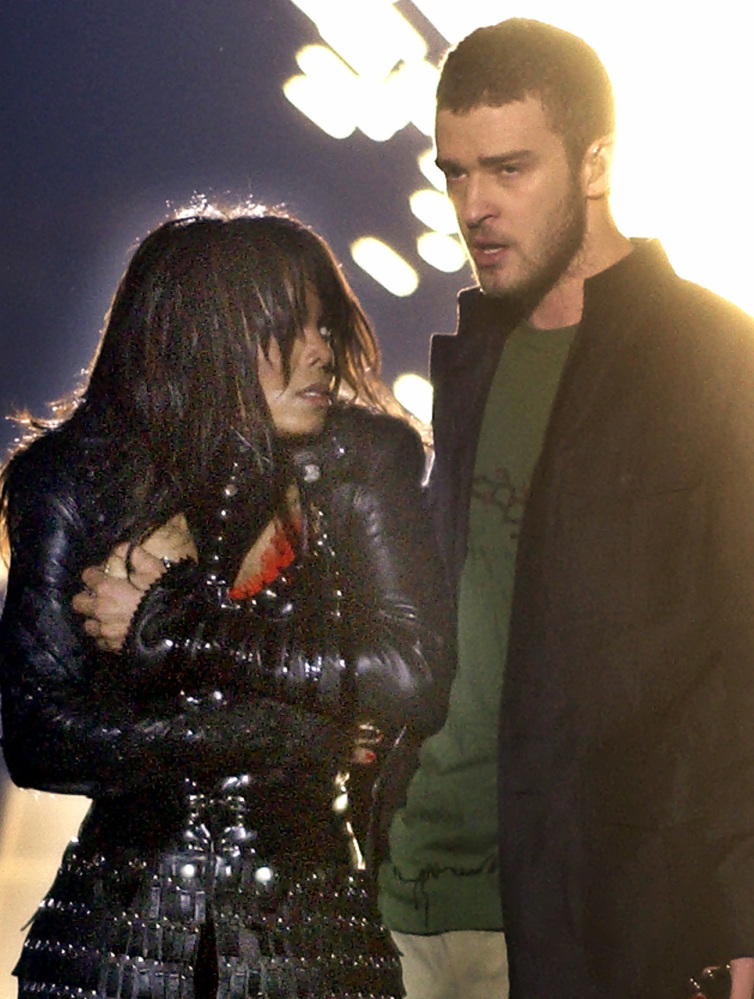 Singer Janet Jackson covers her breast as Justin Timberlake holds part of her costume after her outfit came undone on Feb. 1, 2004.