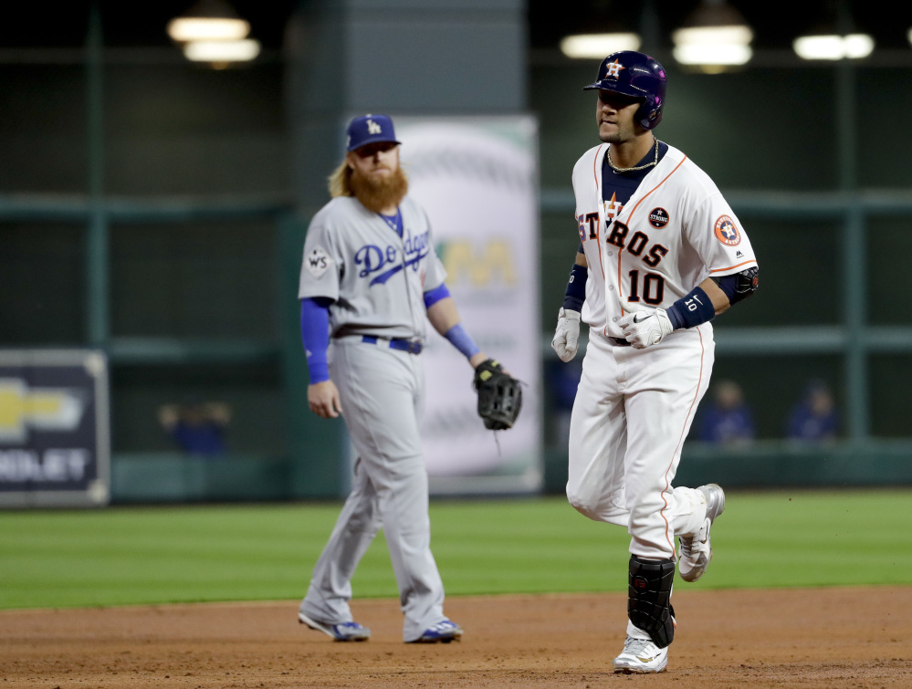 Houston's Yuli Gurriel rounds the bases after hitting a home run during the second inning of Game 3 on Friday night in Houston.