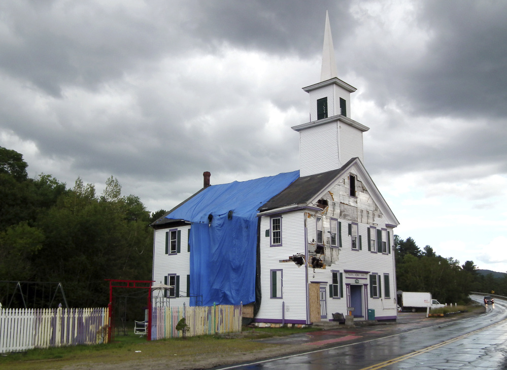 The Grafton Center Meetinghouse in Grafton, N.H., was damaged by a fire last year.