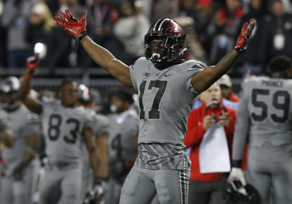 Ohio State receiver Elijaah Goins begins to celebrate as time runs off the clock Saturday. Ohio State, trailing by 15 points in the final period, came back for a 39-38 victory against Penn State at Columbus, Ohio.