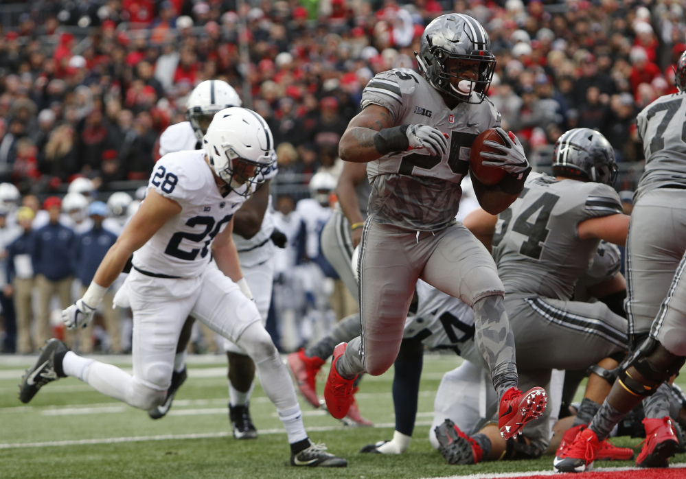 Ohio State running back Mike Weber, right, scores a touchdown against Penn State during the first half of an NCAA college football game Saturday, Oct. 28, 2017, in Columbus, Ohio. ()