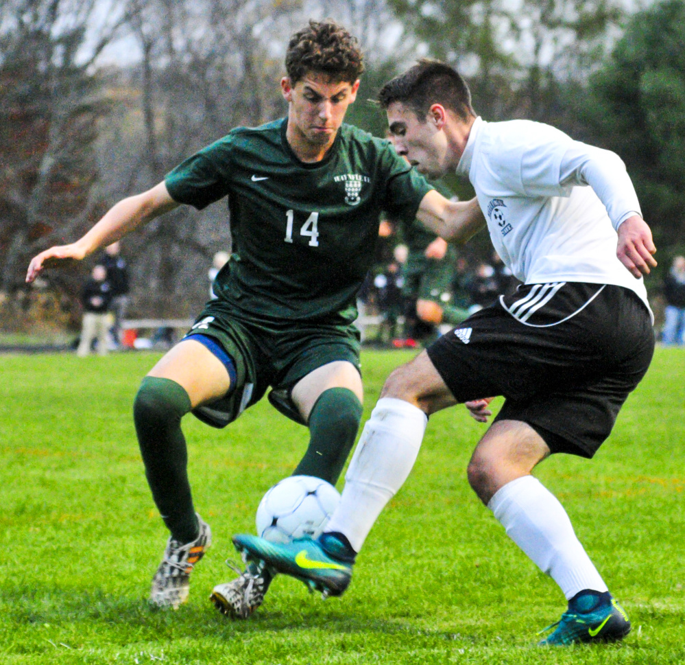 Waynflete's Miles Lipton, left, and Maranacook's Micah Charette battle for the ball during their Class C South semifinal Saturday in Readfield. Maranacook won in double overtime, 2-1.