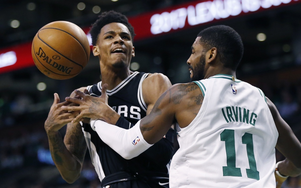 San Antonio's Dejounte Murray loses control of the ball under pressure from the Celtics' Kyrie Irving in the first quarter of Monday night's game in Boston.