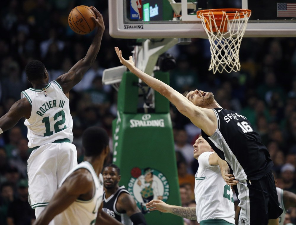 Boston's Terry Rozier grabs a rebound behind the Spurs' Pau Gasol in the third quarter. The Celtics went on to win, 108-94.