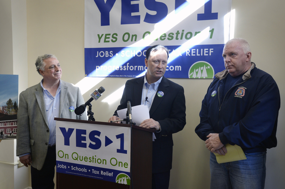 Shawn Scott speaks Tuesday in Portland. He is flanked by John Napolitano, left, and John Leavitt, regional business manager for the New England Regional Council of Carpenters. The York County casino campaign is among the most expensive ballot initiatives in Maine history.