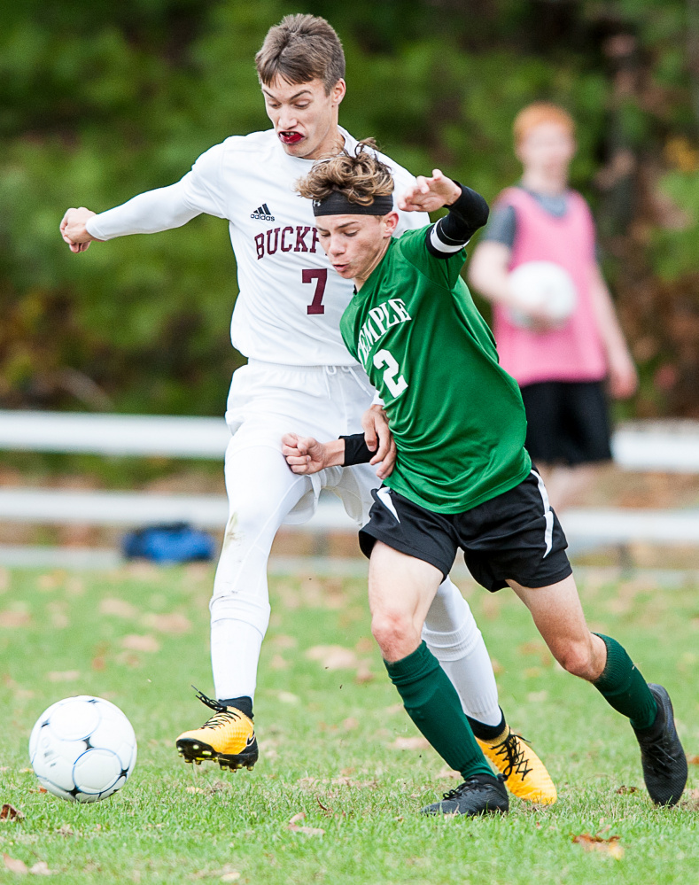 Sun Journal photo by Russ Dillingham   Buckfield's Ethan Jackson (7) and Temple's Micah Riportella vye for a 50/50 ball during the first half of Tuesday's Class D South semifinal game in Buckfield.