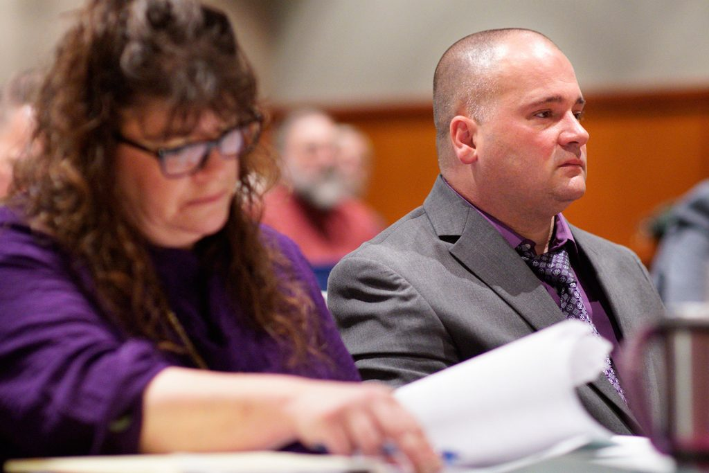 Anthony Sanborn sits in court while his attorney Amy Fairfield looks over paperwork at the Cumberland County Courthouse on the first day of Sanborn's post-conviction review on Tuesday. Sanborn was convicted for the 1989 murder of Jessica Briggs and served 27 years in prison before being released on bail because a key witness for the prosecution recanted her testimony.