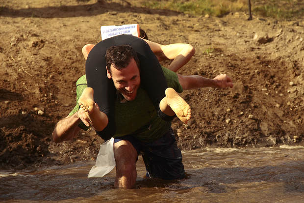 Couples duke it out in wife-carrying contest