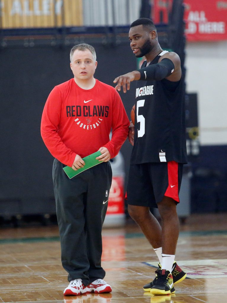Kadeem Allen talks with head coach Brandon Bailey on Monday at the Portland Expo. Allen is one of two players for the Red Claws who will be able to shuttle between Maine and the Boston Celtics this season.