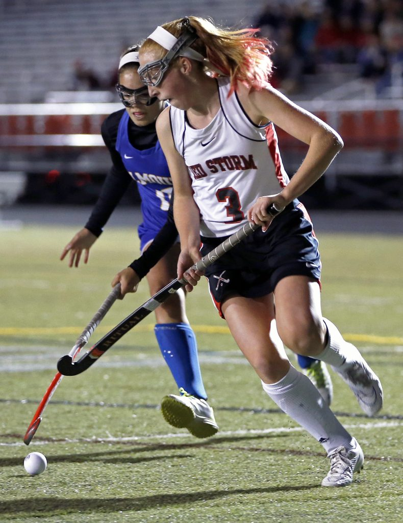 Scarborough forward Carrie Timpson and Falmouth defender Juliana LaPorta vie for possession Tuesday at Scarborough.