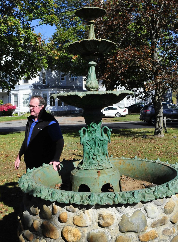 Skowhegan Road Commissioner Greg Dore said his highway crew stood the century-old fountain at Main Street Commons off Main Street in Skowhegan upright Thursday. The fountain had been vandalized recently.
